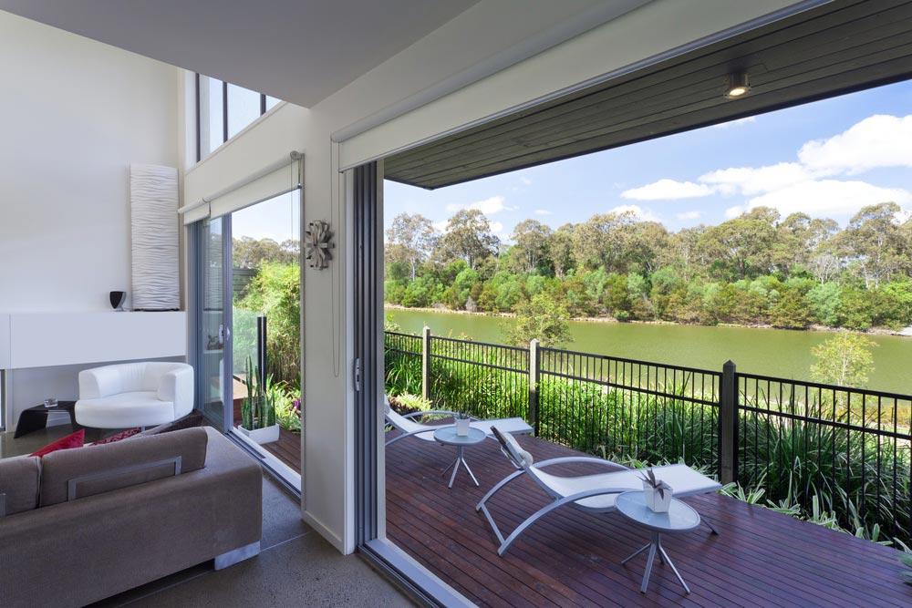 Green sofa - Queenslander Room Makeover - Transform a Sparse Porch with Simple Accessories